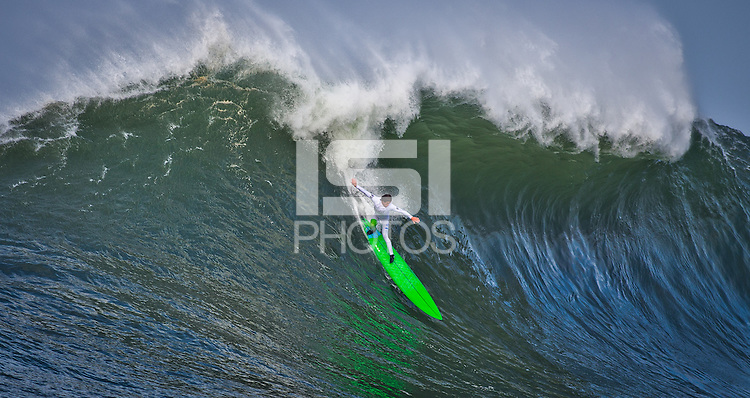 Half Moon Bay, California - January 24, 2014: 2014 Maverick's Invitational Nic Lamb making the drop.