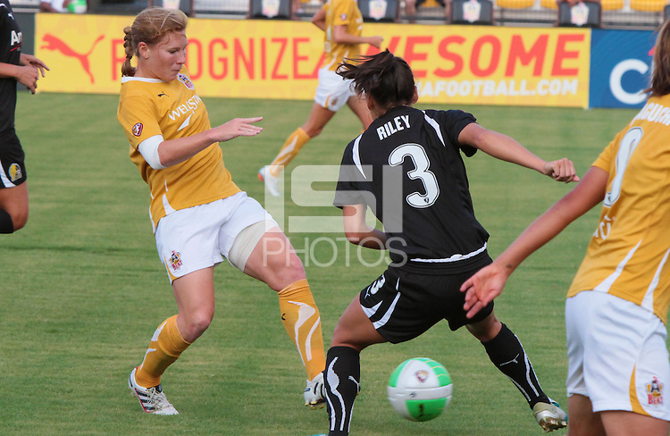 Lori Chalupny (12) versus Ali Riley (3). The FC Gold Pride defeated the Atlanta Beat 6-1 during a Women's Professional Soccer (WPS) match at KSU Atlanta Beat Stadium Kennesaw, GA, on August 28, 2010...