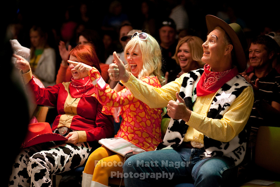 Southwest Airlines Chief Executive Officer and President Gary Kelly (cq), dressed as Woody from Toy Story, and Senior Vice President Culture & Communications Ginger Hardage (cq), enjoyed skits performed by each department during the Southwest Airlines annual Halloween festivities at the headquarters building near Love Field Airport in Dallas, Texas, Friday, October 29, 2010...PHOTO/ MATT NAGER
