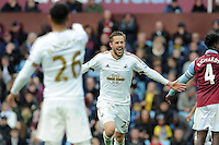 Gylfi Sigurdsson of Swansea City scores the equaliser from a free kick 1-1 and celebrates during the Barclays Premier League match between Aston Villa v Swansea City played at the Villa Park Stadium, Birmingham on October 24th 2015
