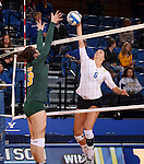 BROOKINGS, SD - OCTOBER 26:  Courtney Roberts #6 from South Dakota State tries for a kill past Jenni Fassbender #13 from North Dakota State in the first game of their match Saturday evening at Frost Arena in Brookings. (Photo by Dave Eggen/Inertia)
