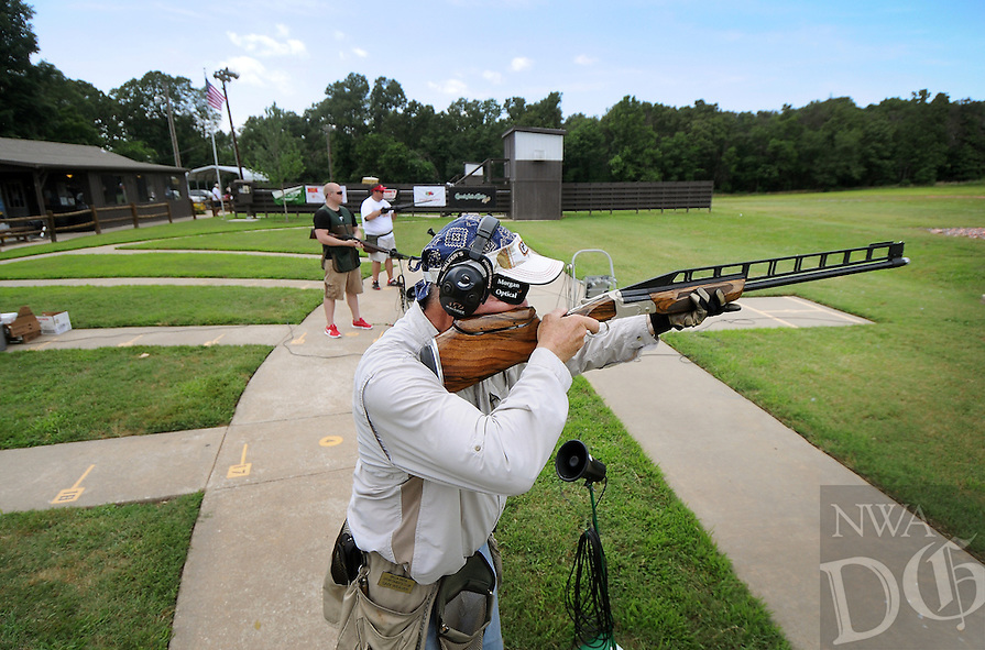 STAFF PHOTO BEN GOFF  @NWABenGoff -- 06/20/14 Sam Weaver, of Bella Vista, fires at a clay while taking part in the 2014 Cancer Challenge Trap Shoot Tournament at Highlands Gun Range near Bella Vista on Friday June 20, 2014.