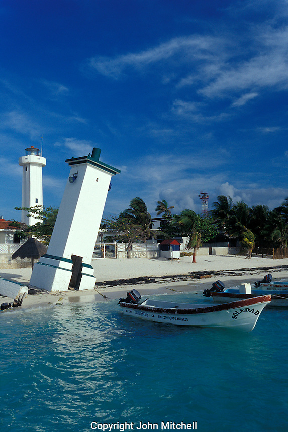 Hurricane damaged tower and lighthouse in Puerto Morelos, Quintana Roo, Mexico