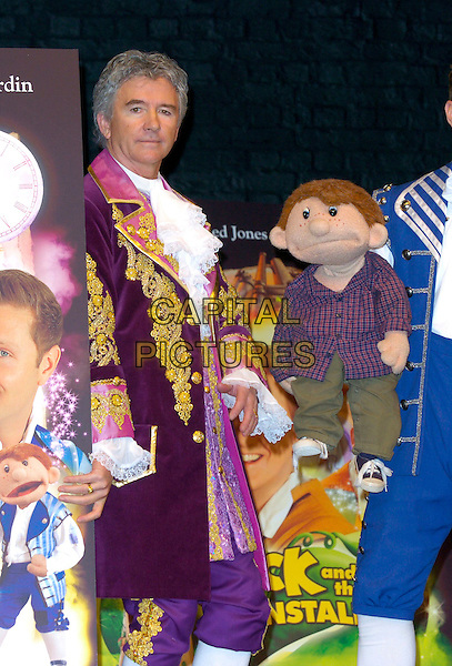 PATRICK DUFFY.The Christmas Pantomime press launch & photocall, Piccadilly Theatre, London, UK..London, UK.November 23rd, 2006.half length costume purple ruffles jacket gold.CAP/CAN.©Can Nguyen/Capital Pictures