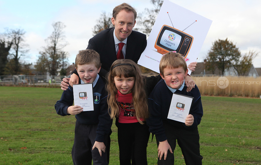 ***NO FEE PIC***.15/11/2010.Minister for Children Barry Andrews TD with (L to r).Paul Fitzpatrick (9) from Sallynoggin,.Kim Mulvaney (8) from Sallynoggin,.Dean Lawlor (7) from Sallynoggin.at the launch of Children's Hope.TV at The Media Cube, IADT,Dun Laoghaire, Co. Dublin..The Irish children's Charity Children's Hope has developed an online educational resource for young people & youth workers, a website caleed www.childrens-hope.tv..The websitte features short curriculm-adhering educational programmes available to be played by young people in after-school projects geared to Youth & Comunity Leaders..Photo: Gareth Chaney Collins