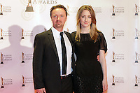 12/2/11 Saoirse Ronan and Paul on the red carpet at the 8th Irish Film and Television Awards at the Convention centre in Dublin. Picture:Arthur Carron/Collins