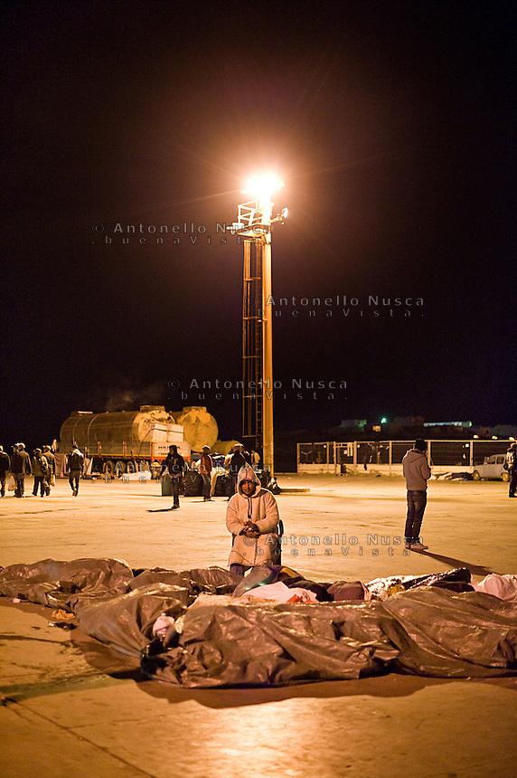Immigrati giunti nel porto di Lampedusa trascorrono la notte all'aperto.<br /> Tunisian immigrants spent the night at the Lampedusa harbor.