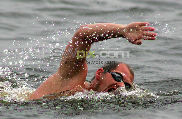 PICTURE BY VAUGHN RIDLEY/SWPIX.COM -  Swimming - Festival of Open Water Swimming - London Regatta Centre, Royal Albert Docks - London, England - 24-25/06/06...? Simon Wilkinson - 07811 267706...Marc-Andre Leclerc of Canada swims in the 10km FINA World Cup.