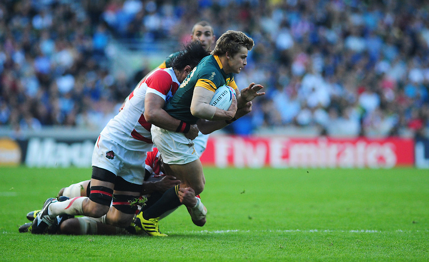 South Africa's Patrick Lambie is tackled by Japan's Hitoshi Ono<br /> <br /> Photographer Kevin Barnes/CameraSport<br /> <br /> Rugby Union - 2015 Rugby World Cup - Japan v South Africa - Saturday 19th September 2015 - The American Express Community Stadium - Falmer - Brighton<br /> <br /> &copy; CameraSport - 43 Linden Ave. Countesthorpe. Leicester. England. LE8 5PG - Tel: +44 (0) 116 277 4147 - admin@camerasport.com - www.camerasport.com