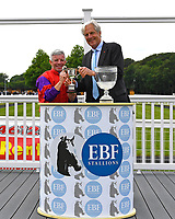 Jockey of Burgonet Franny Norton receives the Margadale trophy on behalf of connections after winning The British Stallion Studs EBF Margadale Fillies' Handicap  during Afternoon Racing at Salisbury Racecourse on 12th June 2018