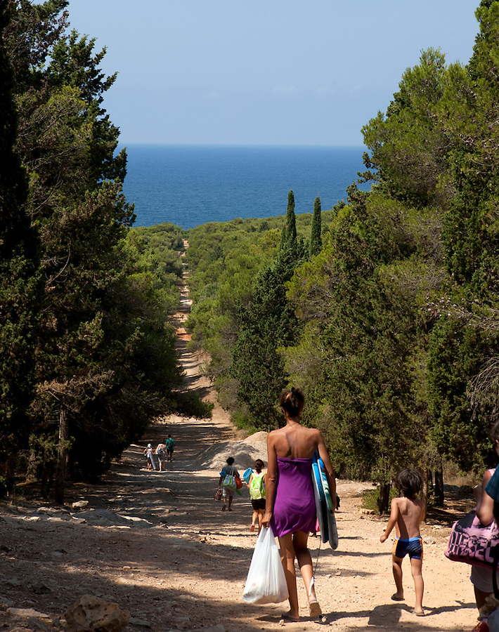 A family walks to the beach in Puglia, Italy, Europe