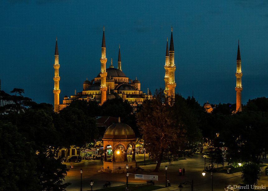 Fine Art Travel Photograph. Night scene of the Sultan Ahmed Mosque, popularly know as the Blue Mosque because of the blue tiles on the interior. It has 6 minarets and 8 domes.