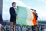 Dr. Tim Horgan and Padraig Mac Fhearghusa hold aloft the original flag that was used by Roger Casement in 1916 and is unveiled at the Casement's 50th anniversary of his monument in Banna on Sunday.