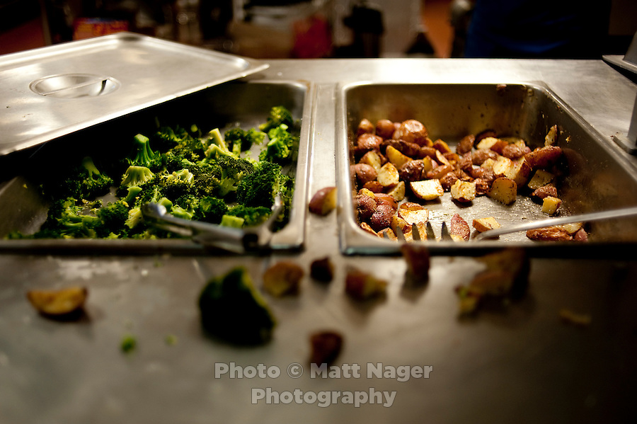 Leftover broccoli and potatoes at the Sigma Alpha Epsilon fraternity house on the Southern Methodist University campus in Dallas, Texas, Friday, january 20, 2011. Some high-end chefs have found professional salvation from an unlikely location: Fraternity Row. ..Matt Nager for The Wall Street Journal