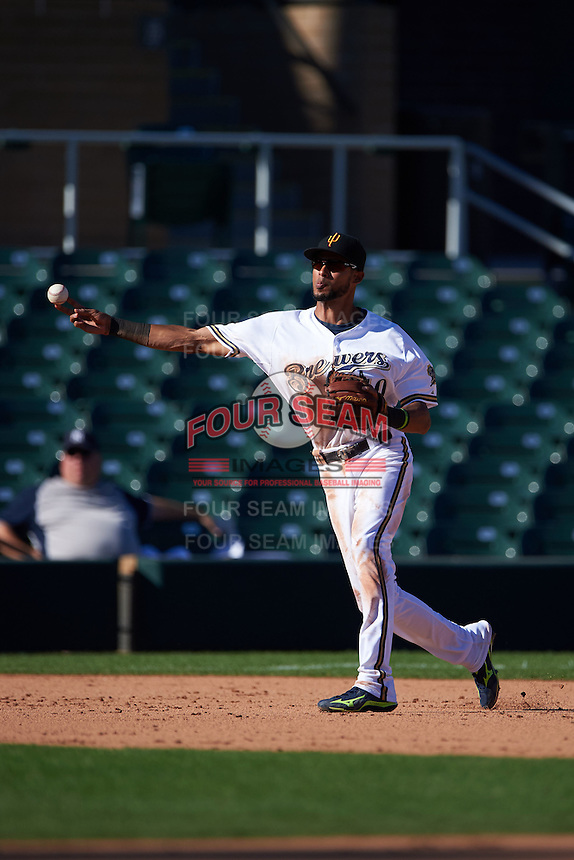 Surprise Saguaros third baseman Yadiel Rivera (10) throws to first during an Arizona Fall League game against the Glendale Desert Dogs on October 23, 2015 at Salt River Fields at Talking Stick in Scottsdale, Arizona.  Glendale defeated Surprise 9-6.  (Mike Janes/Four Seam Images)