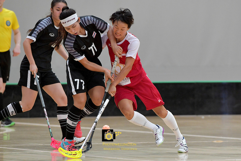 Singapore's Jill Quek and Thailand's Tikhamporn Sakunpithak in action during the World Floorball Championships 2017 Qualification for Asia Oceania Region - Singapore v Thailand at ASB Sports Centre , Wellington, New Zealand on Sunday 5 February 2017.<br /> Photo by Masanori Udagawa<br /> www.photowellington.photoshelter.com.