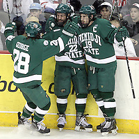 Bemidji State's Ian Lowe (No. 22) is joined by teammates Jordan George and Matt Read after scoring to put BSU up 2-0 during the second period. Bemidji State beat UNO 4-2 Friday night during the first round of the WCHA playoffs at Qwest Center Omaha. (Photo by Michelle Bishop)