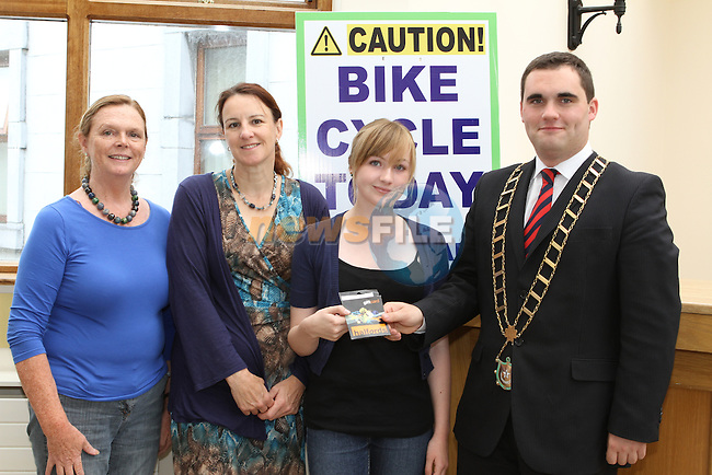 Mayor Kevin Callan presents Maedhbh Honan with her Prize for the Bike Week Art Competition. Pictured here with her mother Sue and Valerie Artherton from Drogheda Boro Council...(Photo credit should read Jenny Matthews www.newsfile.ie)....This Picture has been sent you under the conditions enclosed by:.Newsfile Ltd..The Studio,.Millmount Abbey,.Drogheda,.Co Meath..Ireland..Tel: +353(0)41-9871240.Fax: +353(0)41-9871260.GSM: +353(0)86-2500958.email: pictures@newsfile.ie.www.newsfile.ie.