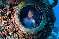 Fabien Cousteau looks out the port view window at the Aquarius Habitat off the coast of Florida.