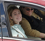 Newsday reporter, Bridget O'Brien, and Photographer Tom Ferrara, in Farmingville on December 31, 2003. Photo by Jim Peppler,