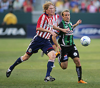 Chivas USA defender Jim Curtin (3) battles Santos forward Vicente Vuoso (30). Chivas USA defeated the Santos of Laguna 1-0 during the 1st round of the 2008 SuperLiga at Home Depot Center stadium, in Carson, California on Wednesday, July 16, 2008.