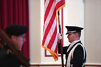 NWA Democrat-Gazette/J.T. WAMPLER Wade Gerlick, cadet colonel in the University of Arkansas Air Force ROTC, retires the colors with the UA honor guard Thursday, November 7, 2019 during the annual Veterans Day Observance Ceremony at the Veterans Health Care System of the Ozarks (VHSO) in Fayetteville. The Helen Tyson Middle School All Girls' Choir performed during the ceremony.