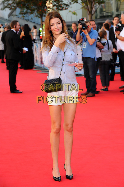 Sarah McDonald.Arrivals to the UK Premiere of 'George Harrison: Living In The Material World' at BFI Southbank, London, England..October 2nd, 2011.full length black bag purse blue shirt white shorts .CAP/CJ.©Chris Joseph/Capital Pictures.
