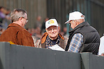 Fans looking over their racing form before the start of race #1 at Oaklawn Park. (Justin Manning/Eclipse Sportswire)
