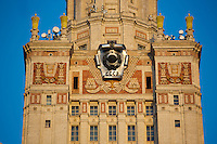 Statues, clocks, and Soviet symbols including stars decorate the main building at Moscow State University in Moscow, Russia.