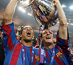 Brazilian player Ronaldinho (left) and Belletti Juliano, hold the trophy after Barcelona beat the Arsenal 2-1.&amp;#xA; Spanish team Barcelona and English team Arsenal play for the Champions League Final, Wednesday May 17<br />