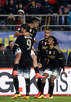 Calcio, Serie A: Frosinone vs Juventus. Frosinone, stadio Comunale, 7 febbraio 2016.<br /> Juventus&rsquo; Paulo Dybala, top, celebrates with teammates, from left, Alvaro Morata, Roberto Pereyra and Juan Cuadrado after scoring during the Italian Serie A football match between Frosinone and Juventus at Frosinone's Comunale stadium, 7 January 2016.<br /> UPDATE IMAGES PRESS/Isabella Bonotto