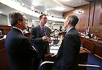 Nevada Senate Republicans, from left, Greg Brower, Ben Kieckhefer and Scott Hammond work on the Senate floor at the Legislative Building in Carson City, Nev., on Wednesday, April 15, 2015.<br /> Photo by Cathleen Allison