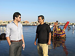 4 November 2012, Karachi, Pakistan.   Friends Sajad Ali and Mehdi Hassan Zafari on Karachi's Clifton Beach. They  moved to the city with their families to escape the weekly target killings of Hazara Shia in Quetta, the capital of Pakistan's Balochistan Province.  Picture by Amanda Hodge/The Australian Magazine..