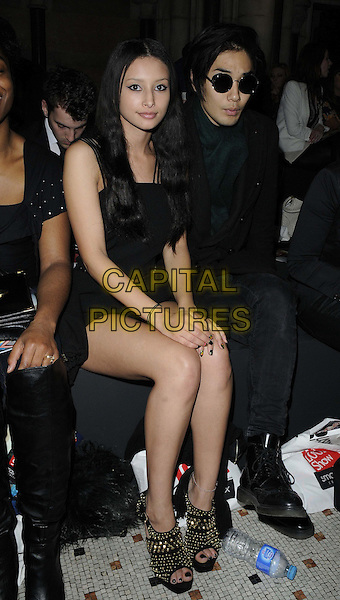 Leah Weller & guest.attended the Look Show in association with Smashbox cosmetics, Royal Courts of Justice, The Strand, London, England, 6th October 2012..full length dress sitting black gold studded studs open toe .CAP/CAN.©Can Nguyen/Capital Pictures.
