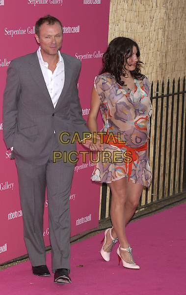 GARY KEMP.Arrives at the Serpentine Gallery Summer Party,.Kensington Palace Gardens,.London, 16 June 2004..full length full-length holding hands pregnant flower print dress red sash belt.www.capitalpictures.com.sales@capitalpictures.com.©Capital Pictures