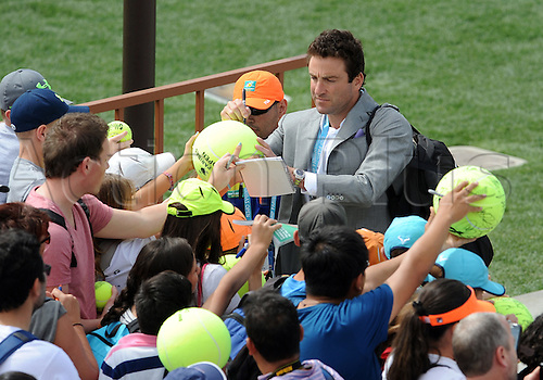 11.03.2016. Indian Wells, California, USA.  Former tennis player Justin Gimelstob (USA) signing autographs during the first round of play at the BNP Paribas Open played at the Indian Wells Tennis Garden in Indian Wells, CA.