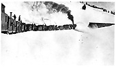 Rotary plowing snow in Cumbres Pass with three engines.  Dorman states in his Chama/Cumbres book that the date of the photo is ca. 1910-1912.<br /> D&amp;RG  Cumbres Pass, CO  ca 1904
