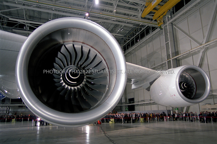 1/18/2004--Toulouse, France..Rolls Royce Trent 900 engines on the first Airbus A380 super jumbo is unveiled to the public at a huge ceremony held in the south of France attended by  British Prime Minister Tony Blair, French President Jacques Chirac, Spanish Prime Minister Jose Luis Rodriguez Zapatero and German Chancellor Gerhard Schroeder.  Due to enter service in 2006, the A380 will replace the Boeing 747 jumbo as the world's biggest passenger aircraft; the 555 seat A380-800, with a non-stop range of 8,000 nautical miles, was launched in December 2000. The aircraft entered production in January 2002. The first flight (with the Rolls-Royce engines) is scheduled for March, 2005 and entry into service for early 2006. ..Airbus's double-decker passenger jet will be the largest airliner ever built. In a one-class configuration, the A380 could accommodate as many as 840 passengers. The more likely three-class configuration will still offer an unprecedented 555 passenger seats. The A380 would offer 30% - 50% more seating than its direct competition, the Boeing 747-400...European aircraft maker Airbus launched production of its A380 ?superjumbo,? the biggest ever commercial airliner, stepping up its challenge to U.S. rival Boeing Co. which has staked its future on a new mid-sized jet...Photograph by Stuart Isett.©2004 Stuart Isett. All rights reserved