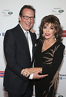 BEVERLY HILLS, CA - NOVEMBER 7: Percy Gibson and Joan Collins at the Mark Zunino Atelier Fashion and Cocktail Reception to benefit the Elizabeth Taylor Foundation hosted by Dame Joan Collins on November 7, 2019.        <br /> CAP/MPI/SAD<br /> ©SAD/MPI/Capital Pictures