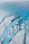 Melted water on the Greenland ice sheet forms channels and rivers that feed into and out of lakes. Thousands of lakes dot the margin of the ice sheet, some with a diameter of more than two miles.