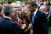 United States President Barack Obama hugs an audience member following remarks at an Earth Day reception in the Rose Garden at the White House in Washington, D.C., U.S., on Thursday, April 22, 2010. .Credit: Brendan Hoffman - Pool via CNP