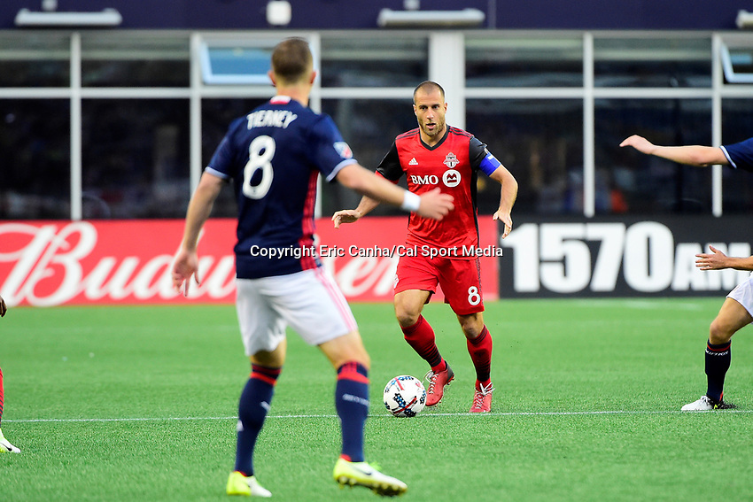June 3, 2017: Toronto FC midfielder Benoit Cheyrou (8) looks for a route around New England Revolution defender Chris Tierney (8) during the MLS game between Toronto FC and the New England Revolution held at Gillette Stadium in Foxborough Massachusetts. At halftime the Revolution lead Toronto FC 1-0. Eric Canha/CSM