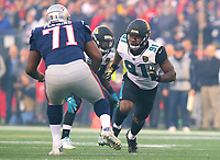Jacksonville Jaguars defensive end Yannick Ngakoue (91) rushes against the New England Patriots in the AFC Championship game Sunday, January 21, 2018 in Foxboro, MA.  (Rick Wilson/Jacksonville Jaguars)