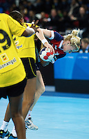 23 NOV 2011 - LONDON, GBR - Britain's Lynn McCafferty (right, in blue and red) tries to force her way through the Angolan defence during the 2011 London Handball Cup match at The Handball Arena in the Olympic Park in Stratford, London .(PHOTO (C) NIGEL FARROW)