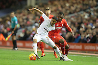 Kyle Naughton competes with Christian Bentekeduring the Barclays Premier League Match between Liverpool and Swansea City played at Anfield, Liverpool on 29th November 2015
