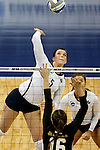 SIOUX FALLS, SD - DECEMBER 8:  Riley Hanson #5 from Concordia St. Paul gets a kill past Annie Boele #16 from American International during their quarterfinal match at the Women's DII Volleyball Championships at the Sanford Pentagon in Sioux Falls, SD. (Photo by Dave Eggen/Inertia)