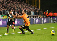 Newcastle United's Isaac Hayden holds off a challenge from Wolverhampton Wanderers' Diogo Jota<br /> Photographer Lee Parker/CameraSport<br /> <br /> The Premier League - Wolverhampton Wanderers v Newcastle United - Saturday 11th January 2020 - Molineux - Wolverhampton<br /> <br /> World Copyright © 2020 CameraSport. All rights reserved. 43 Linden Ave. Countesthorpe. Leicester. England. LE8 5PG - Tel: +44 (0) 116 277 4147 - admin@camerasport.com - www.camerasport.com