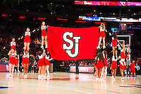 NEW YORK, NY - Sunday December 13, 2015: The St. John's cheerleading squad performs a routine during half-time.  St. John's defeats Syracuse 84-72 during the NCAA men's basketball regular season at Madison Square Garden in New York City.