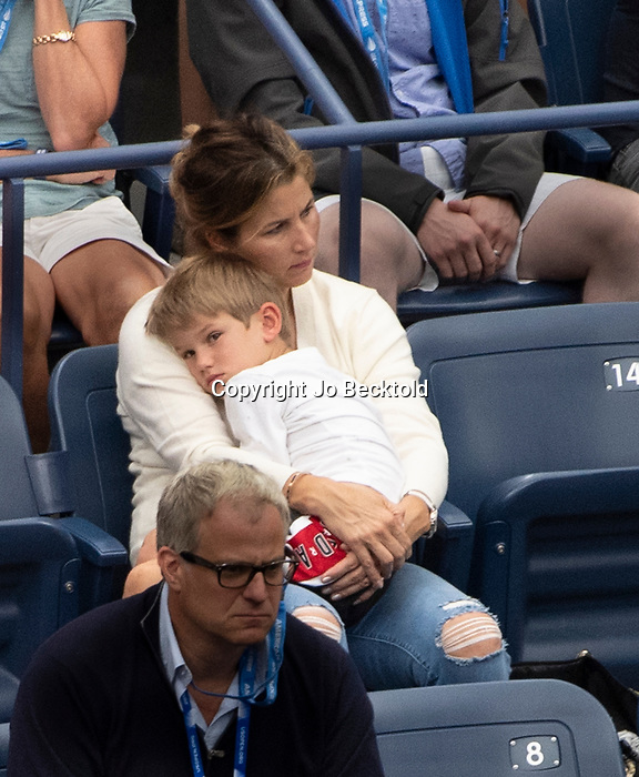 August  28, 2019:  Mirka Federer holds her son during Roger Federer's match at the US Open being played at Billie Jean King National Tennis Center in Flushing, Queens, NY.  ©Jo Becktold