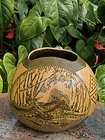 Hawaiian gourd decorated in ancient Ni'ihau style, showing a woman making kapa cloth